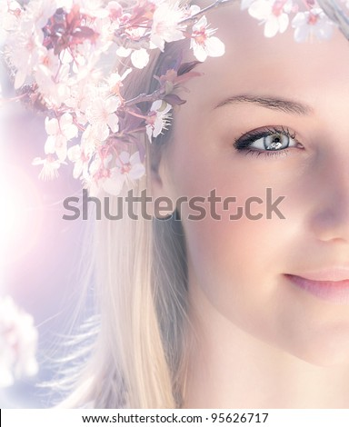 Sensual portrait of a spring woman, beautiful face female enjoying cherry blossom, dreamy girl with pink fresh flowers outdoor, seasonal nature, tree branch and glamorous lady - stock photo