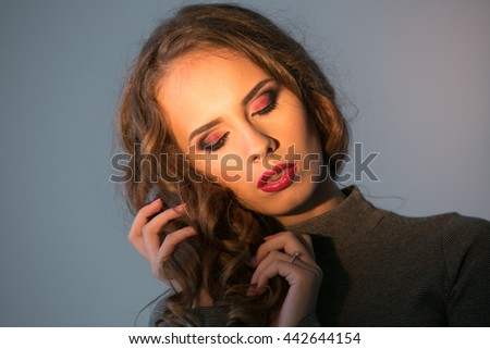 sensual portrait of an attractive sexy young woman - stock photo