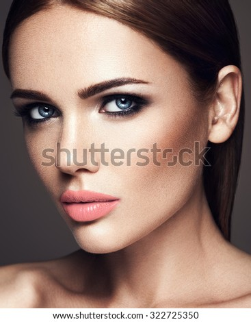 sensual portrait of beautiful  woman model lady with fresh daily makeup with nude lips color and clean healthy skin face