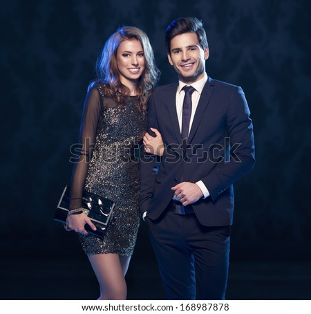 Sensual portrait of cute smiling couple  - stock photo