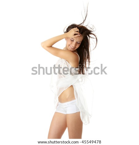 Sensual portrait of young beautiful caucasian woman in white lingerie dancing with wind. Isolated on white - stock photo