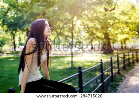 Sensual portrait of young beautiful woman relaxing in Central Park. New York City. Filtered image. - stock photo