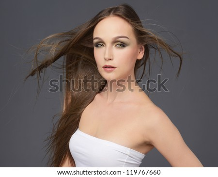Sensual pretty woman with beautiful long brown hairs, posing isolated on white - stock photo
