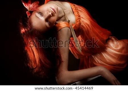 sensual red hair woman in elegant dress, studio shot - stock photo