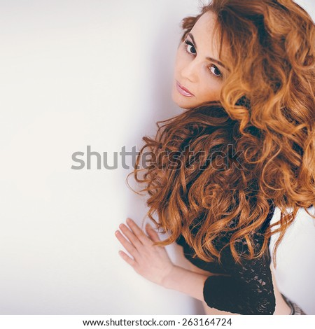 Sensual Red-haired Model with long curly Hair - stock photo