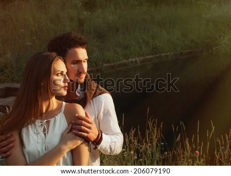 sensual romantic couple enjoying sun  - stock photo