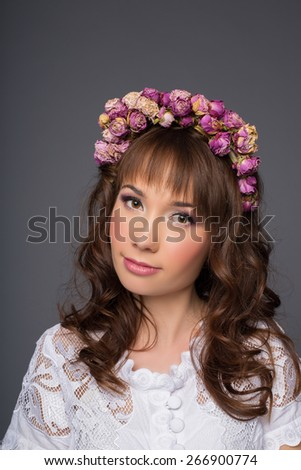 Sensual sexy beautiful curly girl with a floral wreath on her head - stock photo