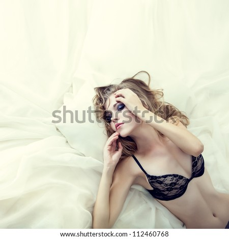 sensual sexy woman in white bed - stock photo