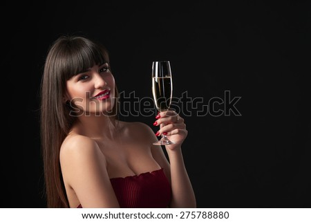 Sensual smiling woman holding a glass with champagne. Closeup portrait with copy space  - stock photo