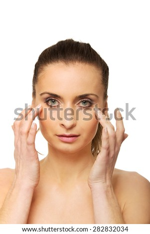 Sensual spa woman with make up touching her face. - stock photo