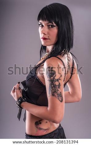Sensual Tattoo Girl. Beautiful and attractive girl with tattoo. Studio shoot. - stock photo
