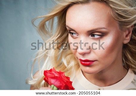 sensual tender delicate young woman portrait with breeze hair and red lips, enjoyment concept on vintage background - stock photo