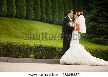 Sensual wedding Couple, groom and bride, holds each other and laughing - stock photo