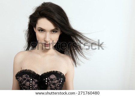 sensual woman in bared shoulder on white background - stock photo