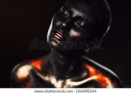 sensual woman in black paint with glitter - stock photo