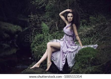Sensual woman in nature scenery - stock photo