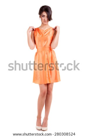 Sensual woman in orange dress isolated over white background. Studio shooting. Sensuality and sexuality. Beauty and fashion - stock photo
