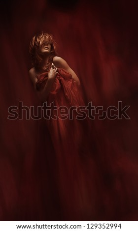 sensual woman in red fabric over art abstract background - stock photo