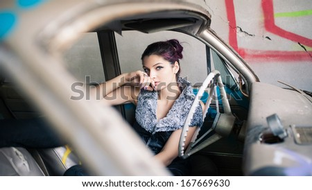 Sensual woman portrait in abandoned car.  - stock photo