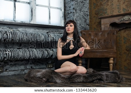 Sensual woman portrait in abandoned  vintage interior, horizontal shot - stock photo