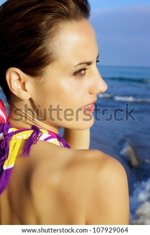 Sensual woman posing on the beach - stock photo