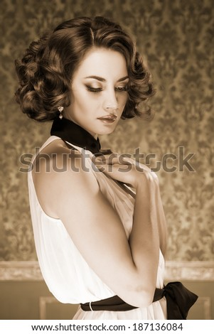 Sensual woman sepia tone vintage image. Professional make up and hairstyle. Studio lighting - stock photo