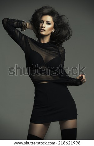 Sensual woman wearing fashionable outfit - stock photo