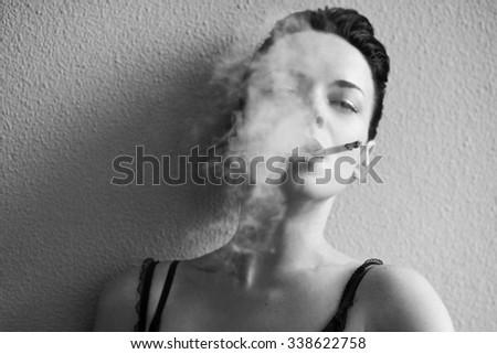 Sensual woman with a cigarette - stock photo
