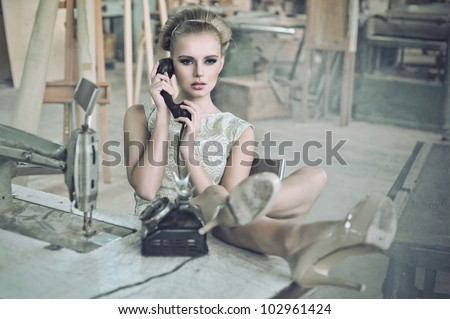 Sensual woman with a phone - stock photo