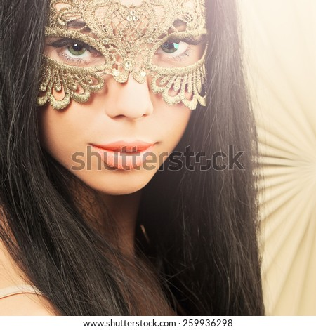 Sensual woman with carnival mask - stock photo