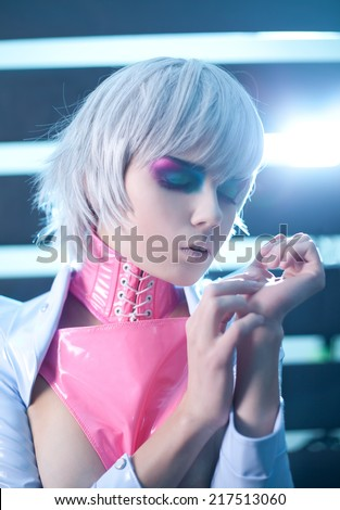 Sensual woman with creative makeup in sci-fi style latex clothes  - stock photo