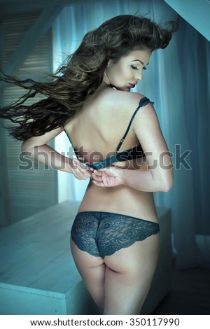 Sensual woman with ideal body wearing lingerie.Photo in bedroom. - stock photo