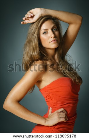 Sensual woman with long strong hair posing in studio - stock photo