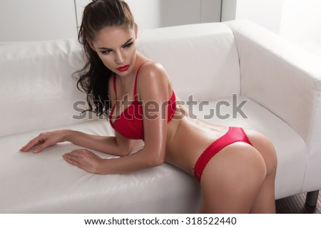 Sensual woman with perfect slim body posing in lingerie - stock photo
