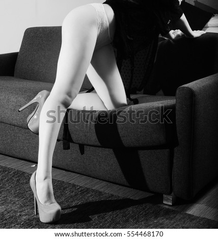 sensual woman with  sexy legs and red shoes-black and white