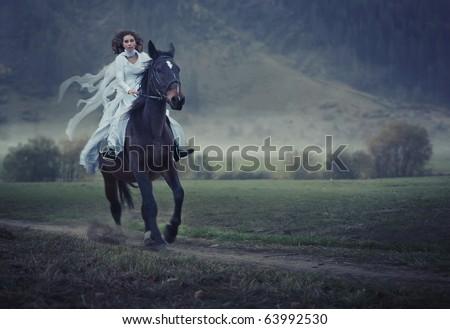 Sensual young beauty riding a horse - stock photo