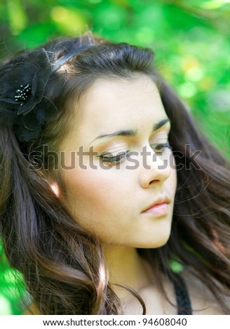 sensual young lady feeling the first rays of spring - stock photo
