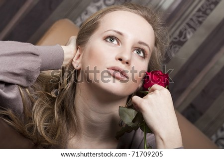 Sensual young lady with a red rose - stock photo