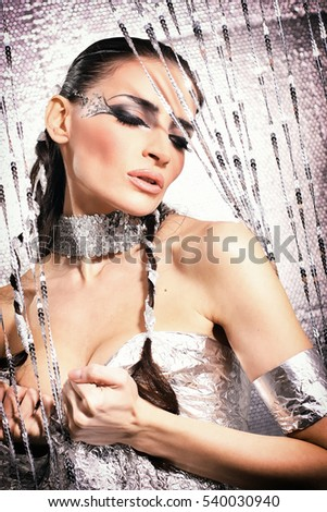 sensual young woman in silver metallic , fashion concept
