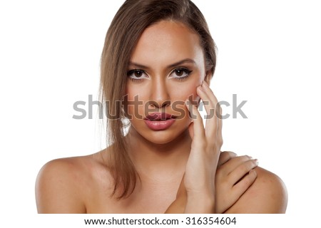 sensual young woman posing on a white background