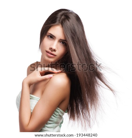 Sensual young woman with beautiful long brown flying hairs