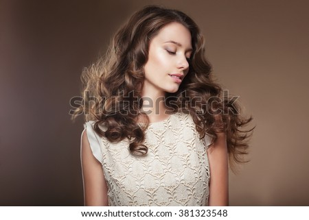 Sensual young woman with beautiful long brown flying hairs. - stock photo