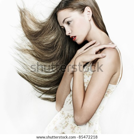 Sensual young woman with beautiful long brown hairs - stock photo