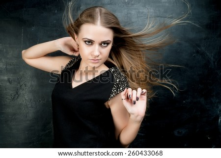 Sensual young woman with beautiful long hairs - stock photo
