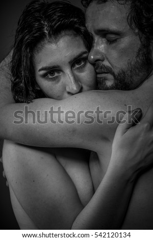 Sensuality, Couple of naked lovers embracing, kissing and caressing each other
