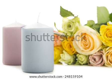 Sentimental gift of roses and candles for your sweetheart on Valentines Day or an anniversary or as a spiritual remembrance to a departed loved one - stock photo