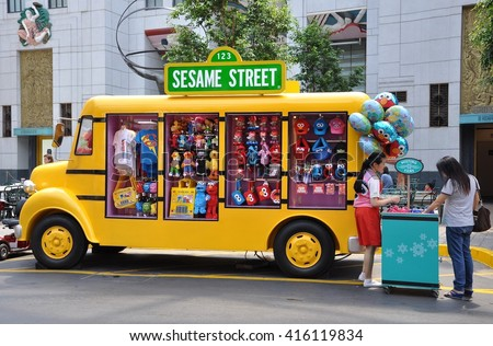 Sentosa, Singapore - June 11, 2014: Yellow truck that sells Sesame Street merchandise at Universal Studios Singapore. - stock photo