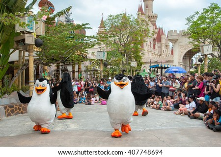 Sentosa Universal Studios, Singapore - 1 March, 2014 : Visitors watching Penguins of Madagascar dancing in the live Madagascar Boogie show - stock photo