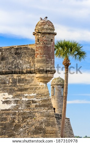 Sentry turrets and a bell tower adorn the corners of the Castillo de San Marcos, an old fort in St. Augustine, Florida when it was a part of the Spanish Empire in the New World (America). - stock photo