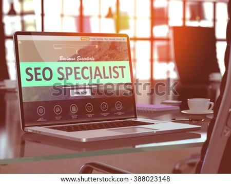 SEO - Search Engine Optimization - Specialist Concept. Closeup Landing Page on Laptop Screen  on background of Comfortable Working Place in Modern Office. Blurred, Toned Image. 3D Render. - stock photo
